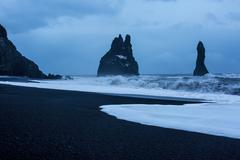 Rock formations and stormy ocean at dusk, Reynisdrangar, Vik, Iceland - stock photo