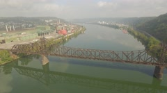 4k Aerial Shot Pulling Way Back from Factory and Steel Bridge on the Ohio River Stock Footage