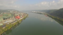 Aerial Shot Flying Down Ohio River to Reveal Factory and Steel Bridge outside St Stock Footage