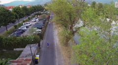 Overhead view of athletes who run along the promenade of river Entella Stock Footage