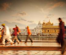 Sikh pilgrims in Golden Temple India - stock photo