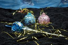 Christmas decoration on black velvet with a blue backdrop, Christmas tree dec - stock photo