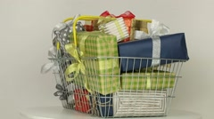 Gifts in shopping basket - stock footage
