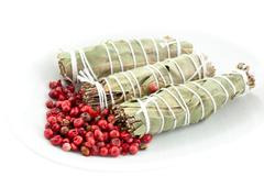 three dry bouquets garni and pink pepper - stock photo