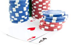 Poker chip stacks and two aces Stock Photos