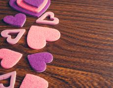 Stock Photo of red and pink hearts on a wooden background