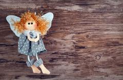 Vintage toy angel figurine on wooden table Stock Photos