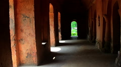 Slow zoom inside a historical building with arches in Assam,India. - stock footage