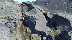 Flying over Trolltunga rock in Norway, aerial footage Stock Footage