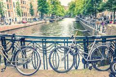 Amsterdam canal and bicycles - stock photo