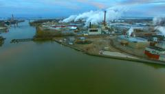 Beautiful factory smokestack plumes at sunrise, aerial view Stock Footage