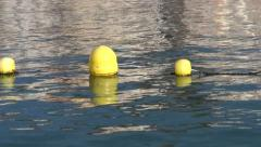 Yellow buoys stringed on the line by the beach in Adeje, Tenerife Stock Footage