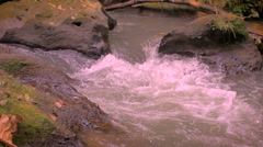 Slow motion pan of fresh, pure, clean, water going down stream in a river Stock Footage