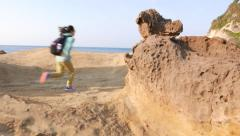 Mushroom rock, hoodoo stone on deserted shore, odd nature creation Stock Footage