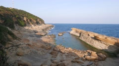 Huge collapsed part of cliff, weathered and washed away rock, Yehliu Geopark Stock Footage