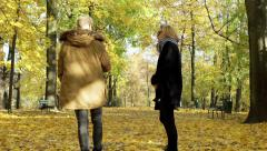 Couple quarreling while walking in the autumnal park Stock Footage