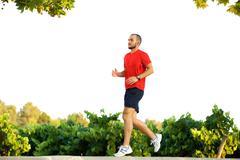 Active man running outdoors - stock photo