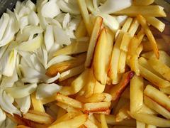 Potato chips and cutting onions - stock photo