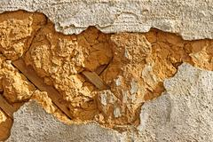 Detail of an old mud walls Stock Photos