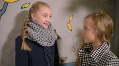 Two Girls Talking secret to each other Stock Footage