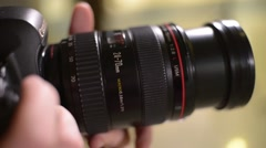 check Canon lens aperture and focus adjustment - stock footage