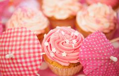 Cupcakes Decorated with Sprinkles, Frosting and Assortments - stock photo