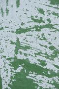 Green Wall with White Paint Scraped Off - stock photo