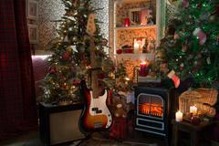 bass guitar in cristmas interior - stock photo