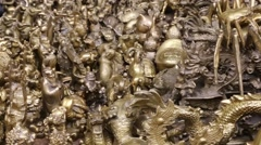 Chinese sculptures of metal at a Panjiayuan Flea Market in Beijing Stock Footage