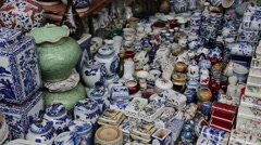 Variety of Chinese ceramics at the flea market in Beijing Stock Footage