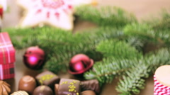 Wrapping assorted chocolates in small boxes for Christmas presents. Stock Footage