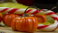 Jack be little (small pumpkin) and candy cane on fallen leaves - panoramic shot Stock Footage