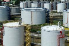 Big industrial oil tanks in a refinery base Stock Photos