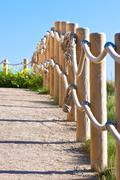 Pathway with wood post fence Stock Photos