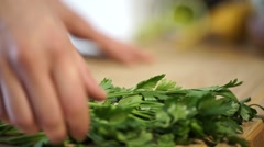 Cook cutting coriander Stock Footage