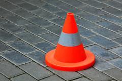 Reflective cone on a road Stock Photos