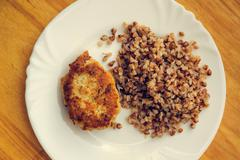 economy food. rissole and buckwheat groats - stock photo