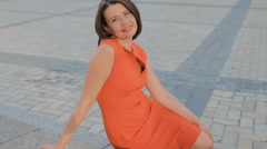 Adult woman in red dress outdoor - stock footage