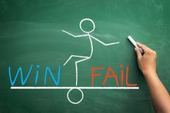 Balance between win and fail Stock Photos