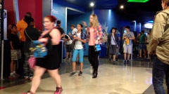 Motion of people coming and leaving at cinema - stock footage