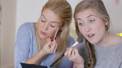 4K Teenage girls hanging out in bedroom, putting on make up & chatting - stock footage