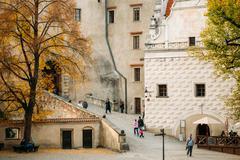 People walking near castle tower in Cesky Krumlov, Czech republi - stock photo