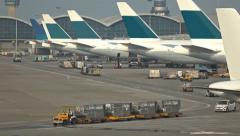 Iternational Airport vehicle loading and unloading cargo in Hong Kong. Stock Footage