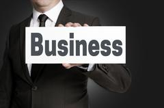 Stock Photo of Business sign is held by businessman concept