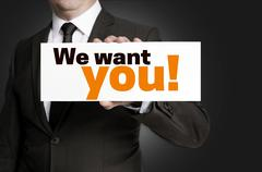 We want you; sign is held by businessman concept - stock photo