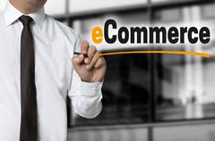 E commerce is written by businessman background concept Stock Photos