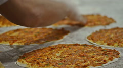 Prepearing Turkish pizza called Lahmacun Stock Footage