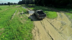 Truck driving through a mud puddle Stock Footage
