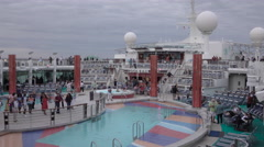 Cruise ship fun passenger by pool line dance 4K Stock Footage