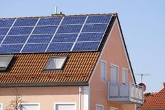 photovoltaic installation on a house roof - stock photo